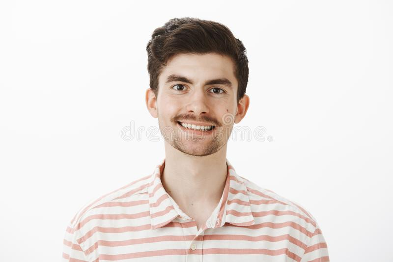 Indoor portrait of pleased handsome ordinary european man with moustache and beard, smiling broadly, feeling confident royalty free stock images