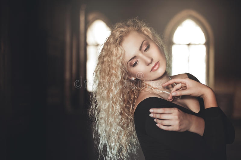 Indoor portrait of young beautiful woman royalty free stock photography