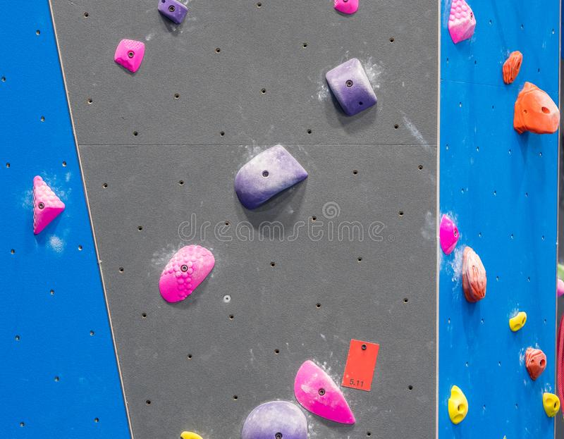 Indoor rock climbing gym. Walls of indoor rock climbing gym stock photography