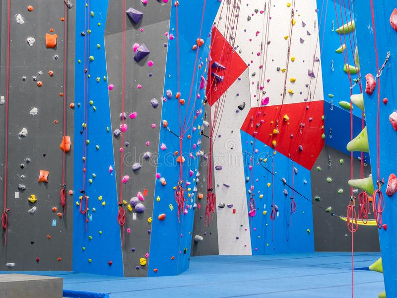 Indoor rock climbing gym. Walls of indoor rock climbing gym stock photo
