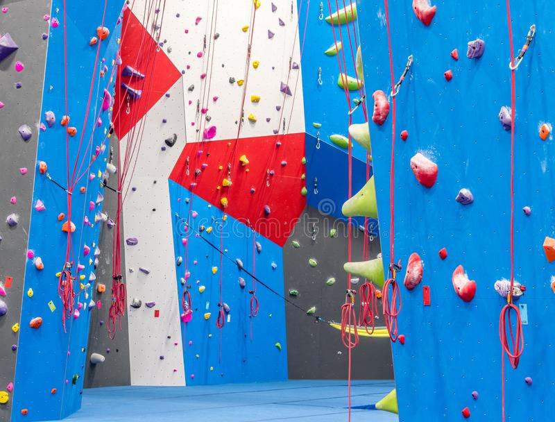 Indoor rock climbing gym. Walls of indoor rock climbing gym stock image