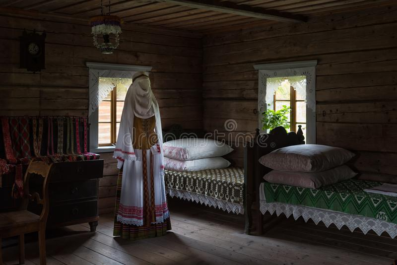 Ancient bedroom interior wooden house Rumsiskes Lithuania. Indoor scene of an ancient wooden house in Rumsiskes Etnographic museum, Lithuania. Bedroom interior royalty free stock images