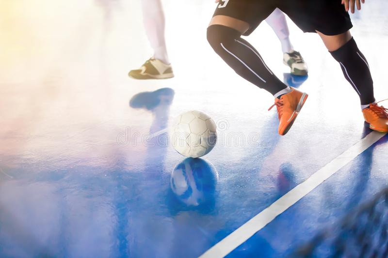 Indoor soccer sports hall. Football futsal player royalty free stock photography