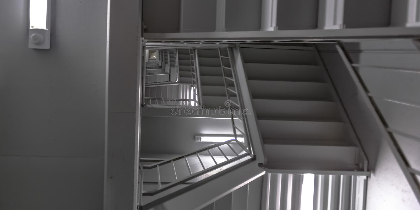 Indoor stairs and ceiling of a modern building stock photo