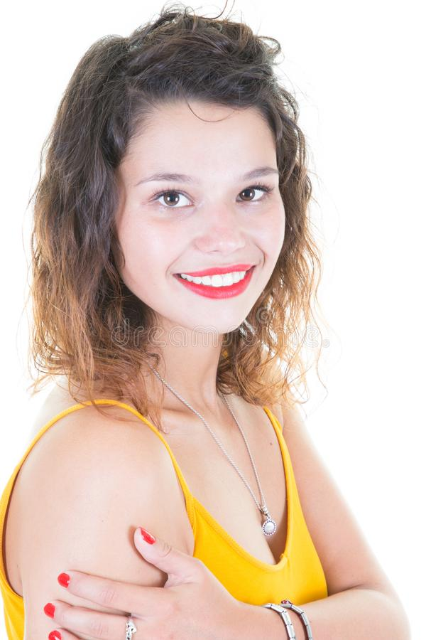 studio shot of happy young woman wears yellow shirt feels joy and glad isolated over white background stock image
