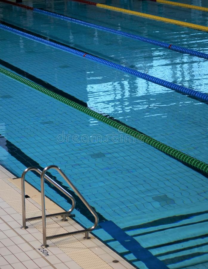 Indoor swimming pool. Ropes divide the swimming lanes of an indoor pool ahead of a swim meet inside a sports arena stock photo