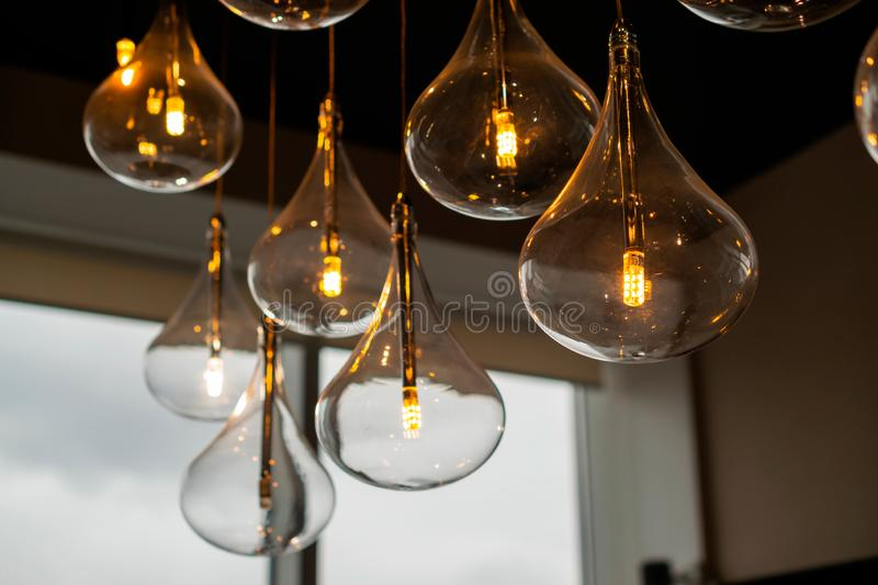 Indoor switched on decorative light bulbs loft design. The room includes decorative luminous bulbs in the loft style. Design of premises with lighting fixtures royalty free stock photography