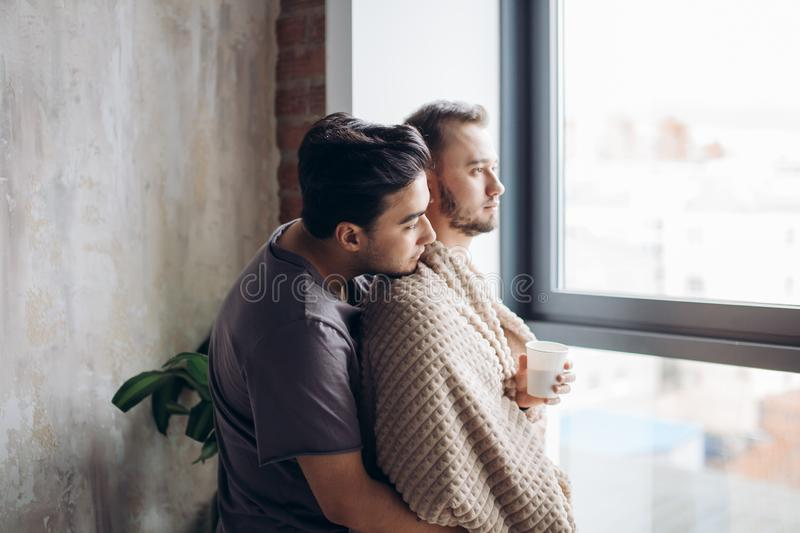 Young loving couple in hotel room in the morning, standing