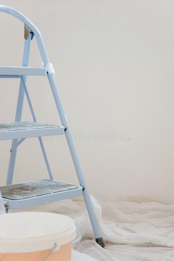 Indoor view of construction site, ladder in foreground and freshpainting walls royalty free stock photo