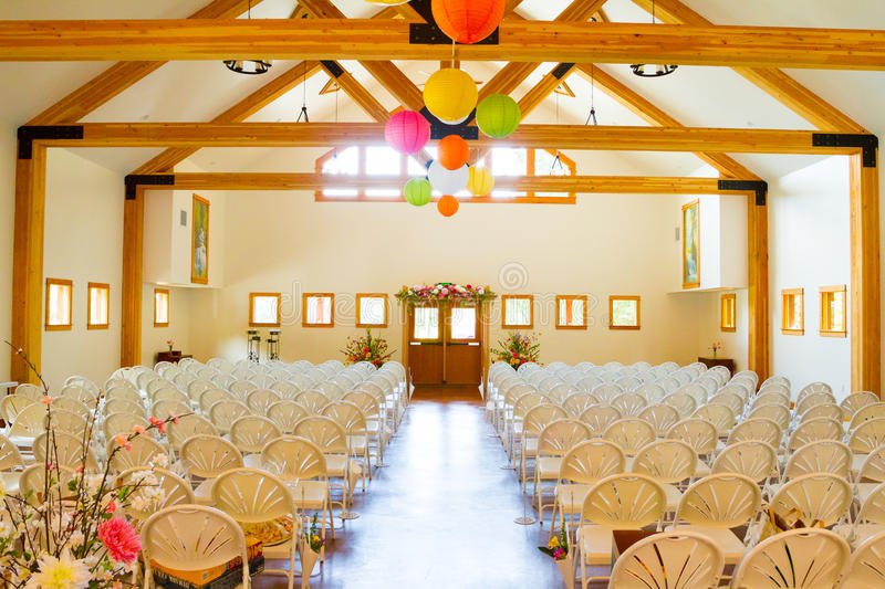 White Chairs At A Wedding Indoor Stock Photo
