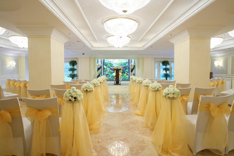 Indoor wedding Scene. Chairs and flowers at a indoor wedding party stock photography