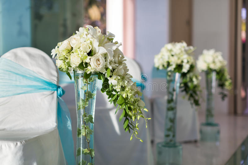 Indoor wedding Scene. Chairs and flowers at a indoor wedding party at seaside royalty free stock images