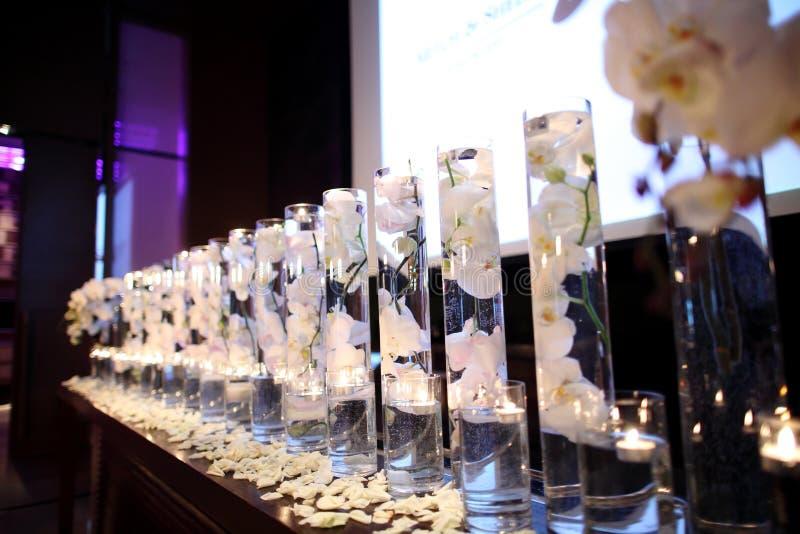 Indoor wedding Scene. Flowers at an indoor wedding royalty free stock photos