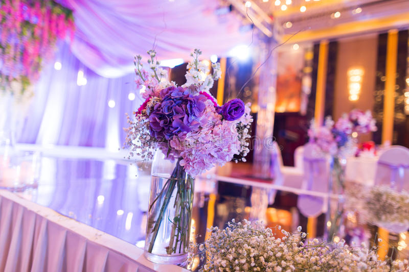 Indoor wedding Scene. Flowers and candles at an indoor wedding royalty free stock photo