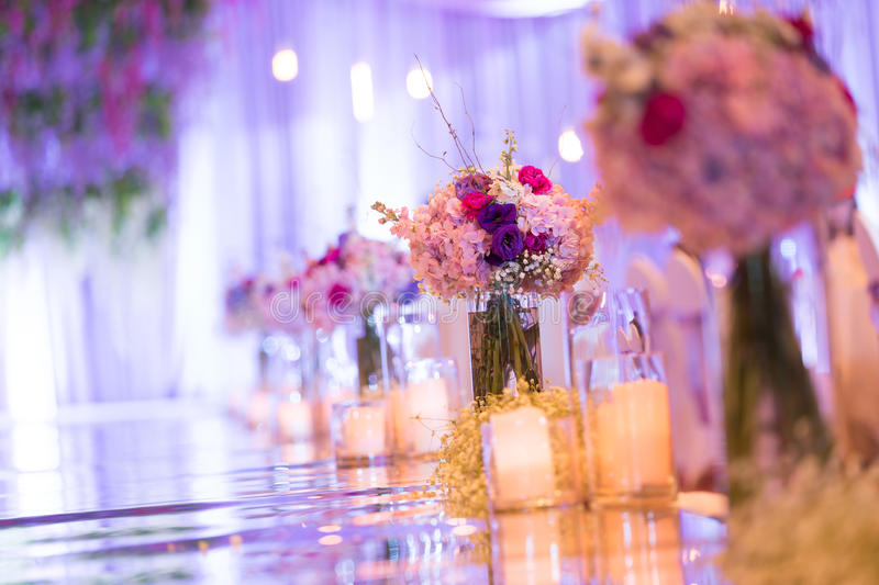 Indoor wedding Scene. Flowers and candles at an indoor wedding stock photo
