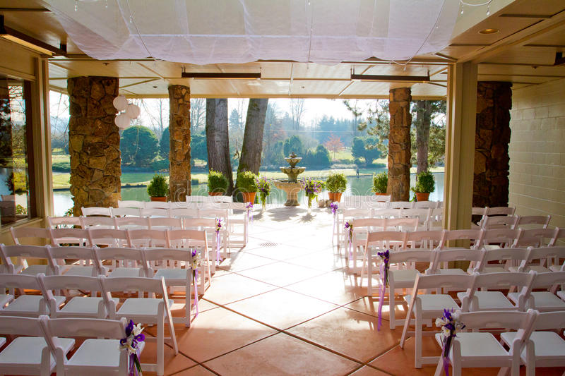 Indoor Wedding Venue. Chairs are lined up and ready for this indoor wedding ceremony at a venue in Oregon royalty free stock photo