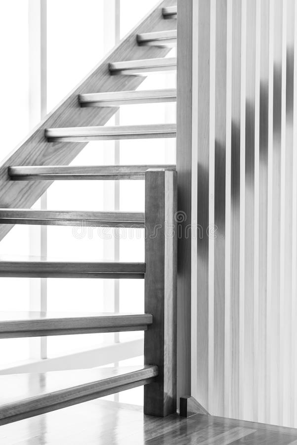 Wooden Staircase Black and White. Indoor wooden staircase with light behind it in black and white stock images