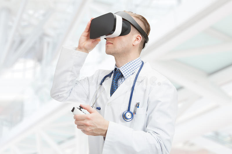 Indoors close up shot of male doctor wearing VR glasses stock photos