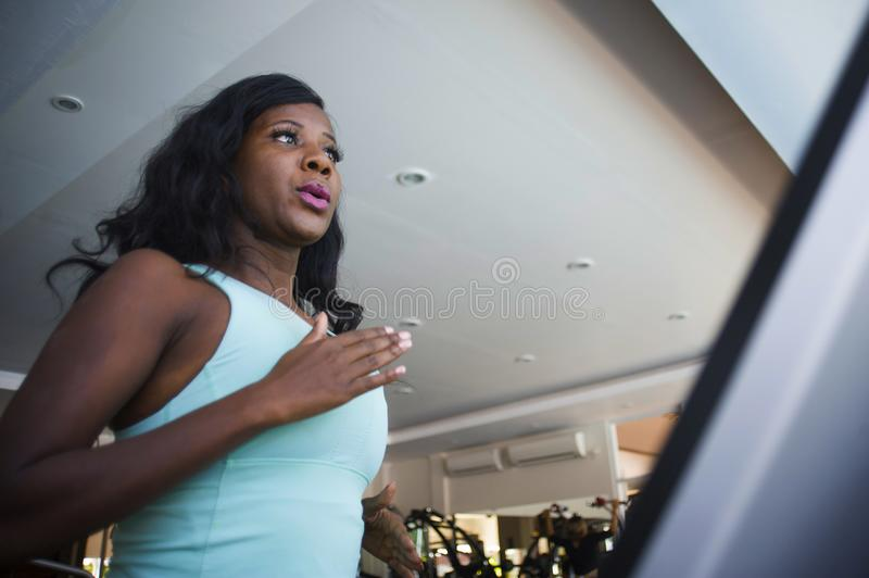indoors gym portrait of young attractive black afro American wom royalty free stock images