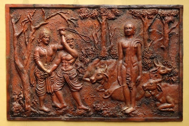 INDRA verhindert een onwetende cowherd aan te vallen Bhagavan Mahavira stock fotografie