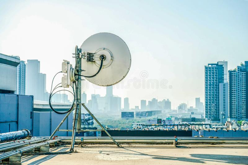 Industrial antenna at the building rooftop royalty free stock photo