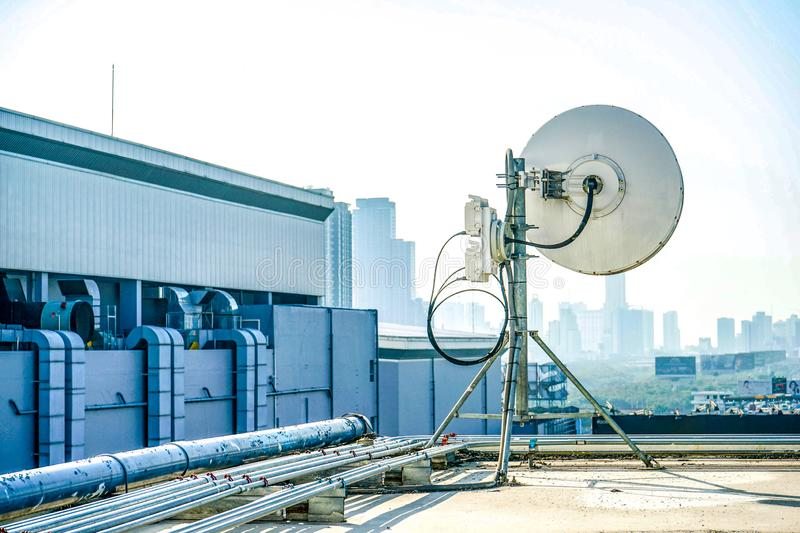 Industrial antenna at the building rooftop stock photos
