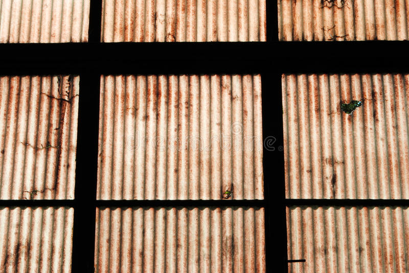 Industrial archeology. Plastic wall in old abandoned factory royalty free stock photos