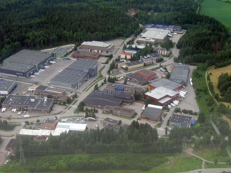 Industrial area. Aerial image of an industrial and retail area surrounded by forests royalty free stock images