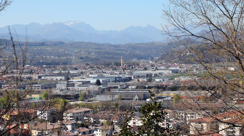 Industrial Area in the Po Valley in Italy and the mountains. In the background stock photos