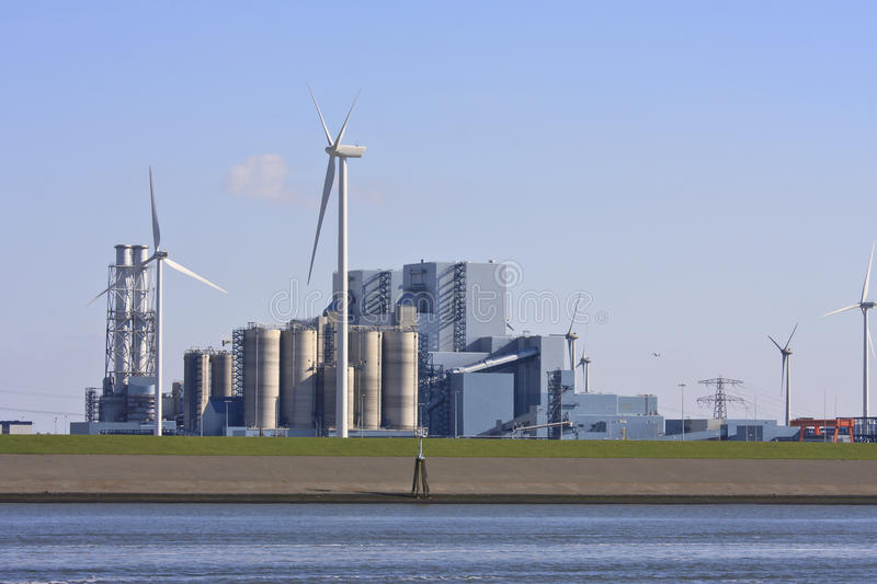 Industrial area and windmills, Groningen, Netherlands royalty free stock images