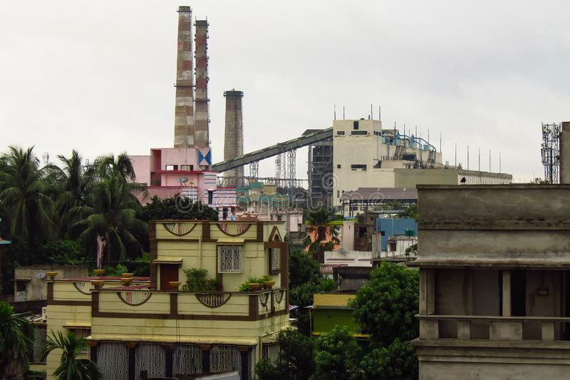 Industrial atmosphere in the city life. Closed Industrial plant due to air pollution in the congested locality of India royalty free stock photos