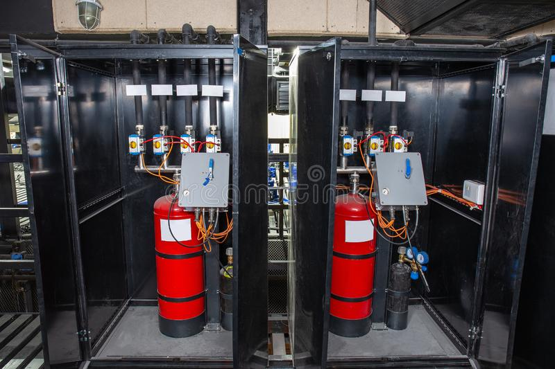 Industrial automatic fire extinguishing system, cabinet with balloon of fire-fighting foam, nitrogen and control unit. Close-up royalty free stock photo