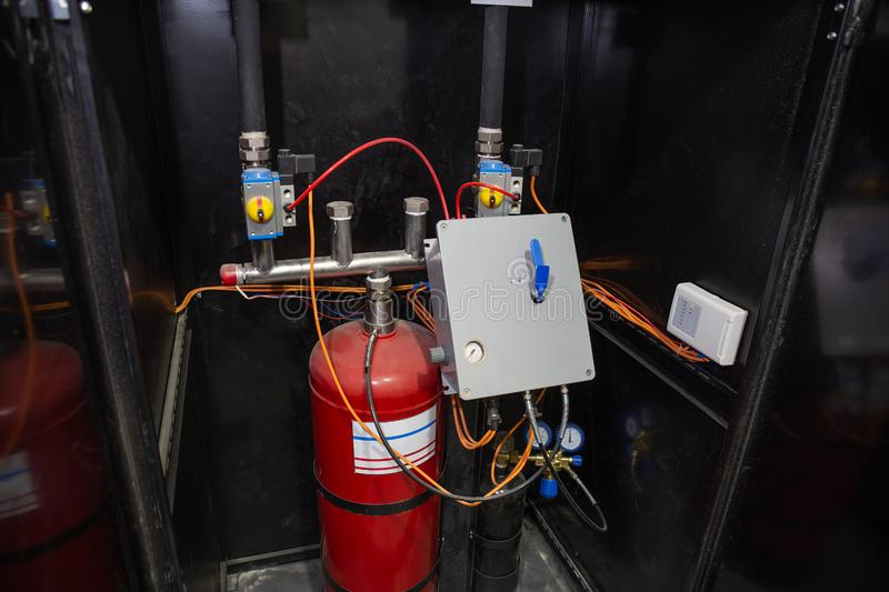 Industrial automatic fire extinguishing system, cabinet with balloon of fire-fighting foam, nitrogen and control unit. Close-up stock photography