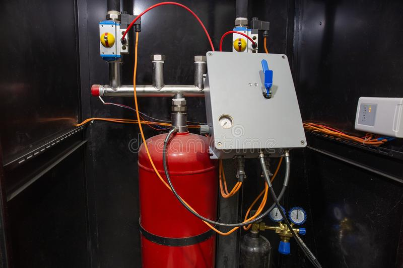 Industrial automatic fire extinguishing system, cabinet with balloon of fire-fighting foam, nitrogen and control unit. Close-up stock images
