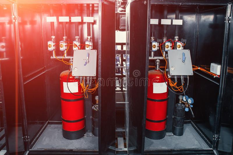 Industrial automatic fire extinguishing system, cabinet with balloon of fire-fighting foam, nitrogen and control unit. Toned royalty free stock photo