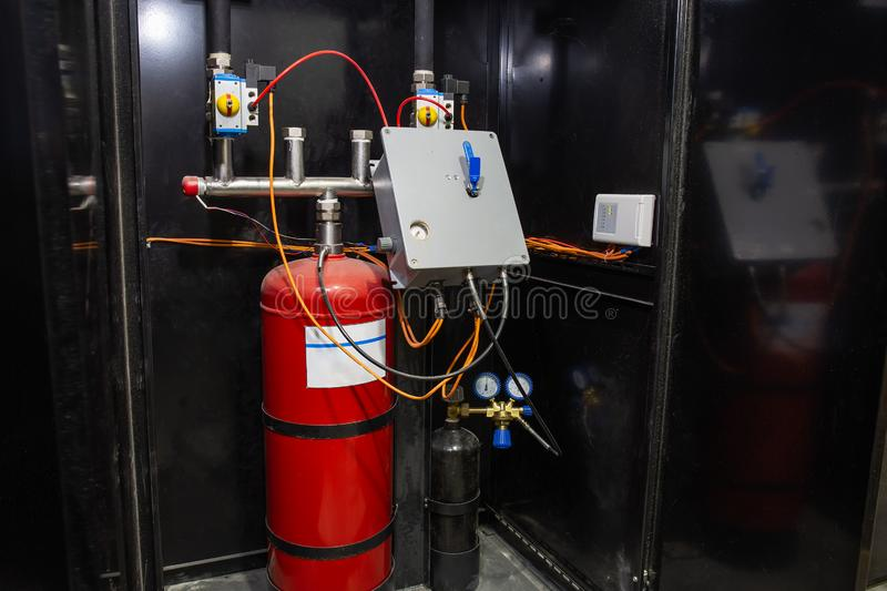 Industrial automatic fire extinguishing system, cabinet with balloon of fire-fighting foam, nitrogen and control unit.  stock photos