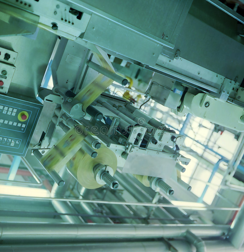 Industrial automation. On packaging products stock photography
