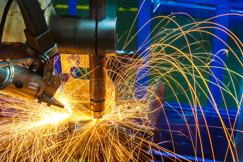 Industrial, automotive spot welding, in a car factory. With sparks, manufacturing, industry stock photos