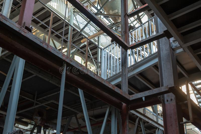 Industrial background, old abandoned factory hall with stairs and day light stock images