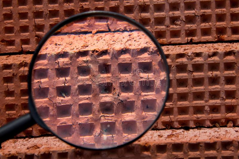 Industrial background through a magnifying glass. Brick texture. Brick blocks used during the construction of a new building stock images