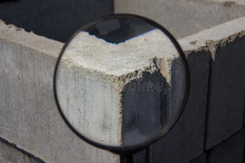 Industrial background through a magnifying glass. Brick texture. Brick blocks used during the construction of a new building stock image