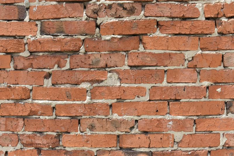 Industrial background,warehouse brick wall with sloppy cement joint. Background of old vintage dirty brick wall close up, texture royalty free stock image