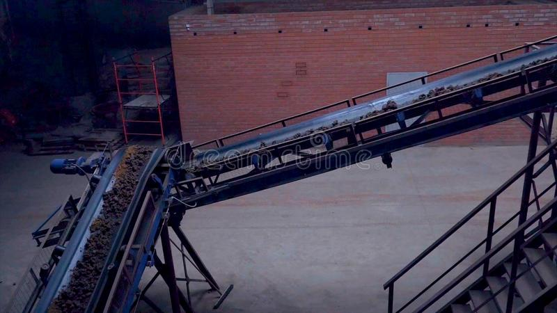 Industrial belt conveyor. Moving Raw Materials. Long conveyor belt transporting ore to the power plant. Extraction of. Ore. Belt conveyor. Extraction of ore stock photography