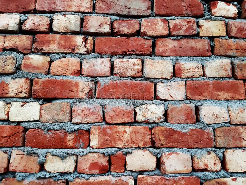 Industrial bricklayer installing bricks on construction site. stock images