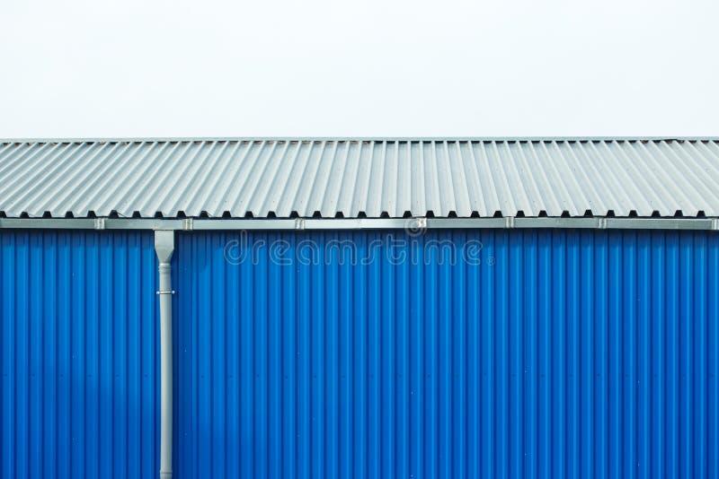 Industrial building blue sheet metal facade, abstract background stock photos