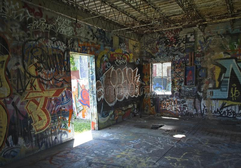 Industrial Building Interior Corner with Colorful Graffiti royalty free stock images