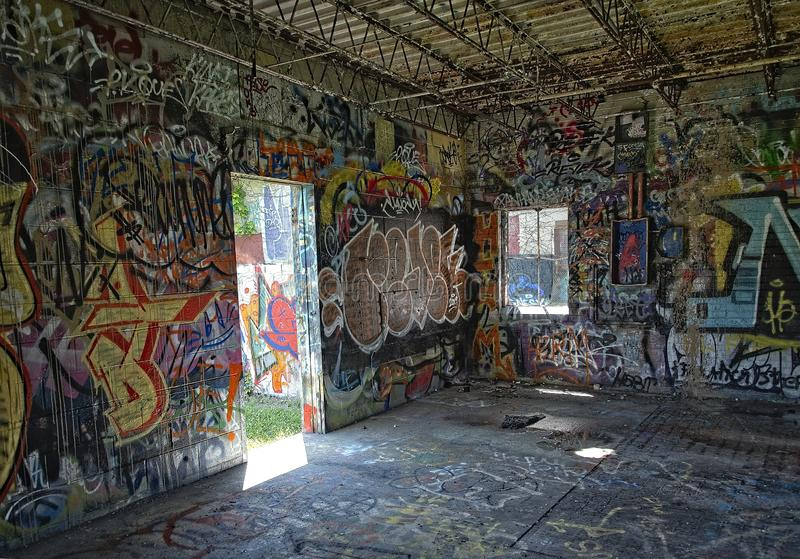 Industrial Building Interior with Graffiti Grunge royalty free stock image