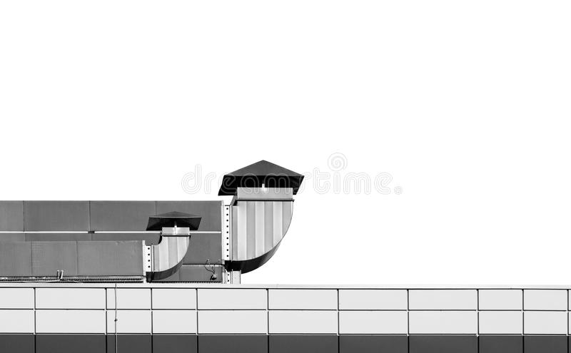 Industrial building roof with ventilation chimneys on white back royalty free stock photos