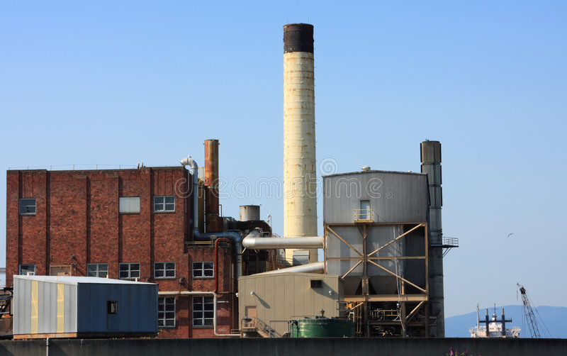 Industrial Buildings Chimney stock images