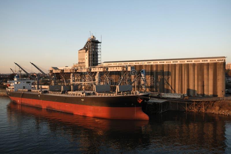 Industrial cargo grain ship dock elevator terminal royalty free stock photo